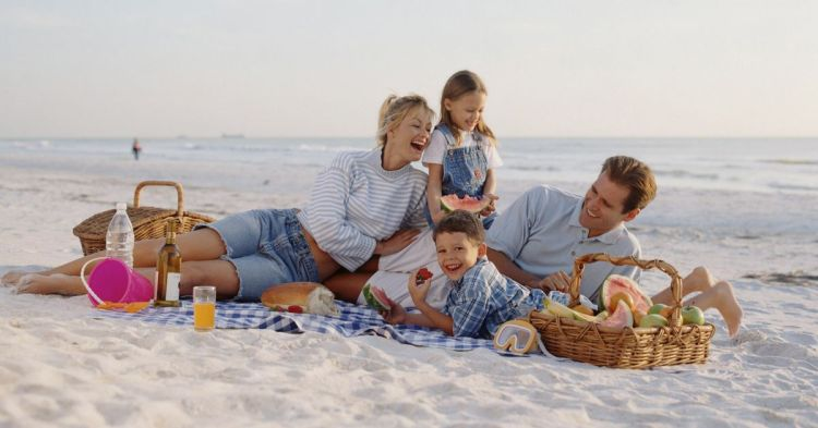 family-having-picnic-on-beach